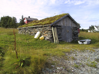 A turf-roofed stone boathouse