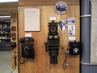 Three old telephones, including an 1880s model