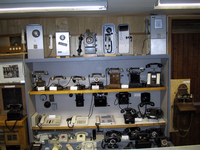 A large array of telephones of various ages