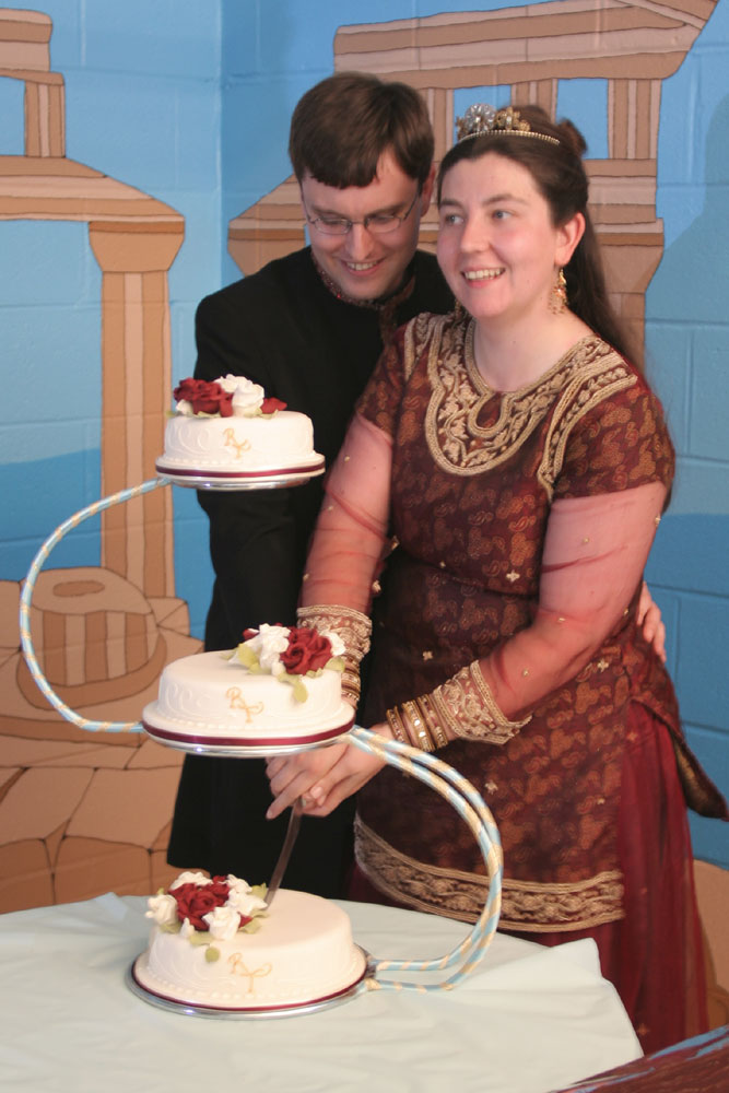 Cutting Wedding Cake With Sword